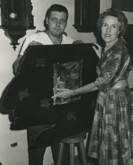 Eleanor Lee Templeman with Unknown Man and Coat Rack